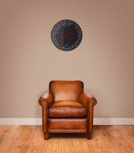 Leather armchair on a wooden floor against a plain background wall with lots of copyspace. The wall has a clipping path.