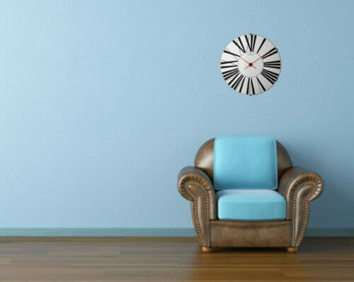 Interior design scene with a modern brown leather couch and lamp on blue wall